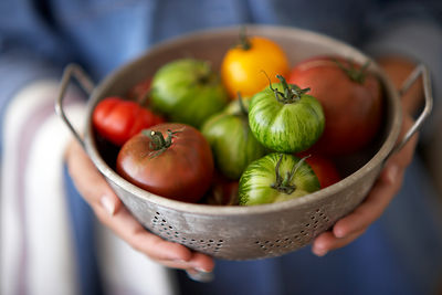 Heirloom tomatoes in a colander