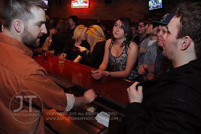 Bar Manager Chris Flanders attends to bar patrons the Airliner Bar, 22 S Clinton Street in downtown Iowa City Saturday night. Copyright Justin Torner 2012 http://justintorner.photoshelter.com