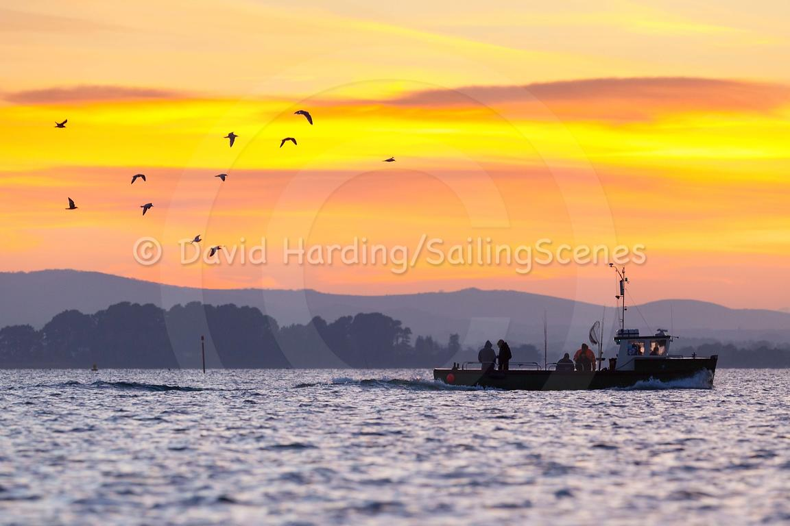 Fishing boat at sunset