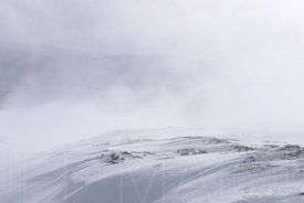 Wind and mist on a mountain snowfield
