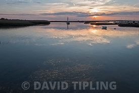 Creek at Brancaster Staithe at high tide on a late summers evening North Norfolk