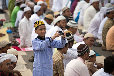 A Muslim boy takes photos during Eid al-Adha, Red Road, Madian, Kolkata, India. I have the only photos taken by a foreigner of this most important day to Muslims at the most auspicious site in Kolkata for both 2012 and 2013.