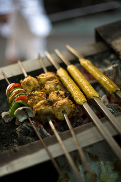 India - Delhi - A cook prepares fresh kebabs at Karim's Restaurant