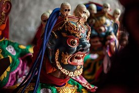 Dancers with masks for the cham dance, which is associated with some sects of Buddhism at Punakha Dzong, Bhutan.