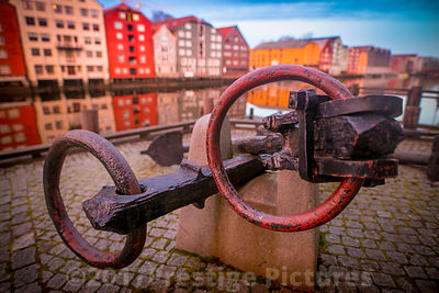 Historical Anchor by the famous Wooden Buildings in the Bakklandet district of old Trondheim