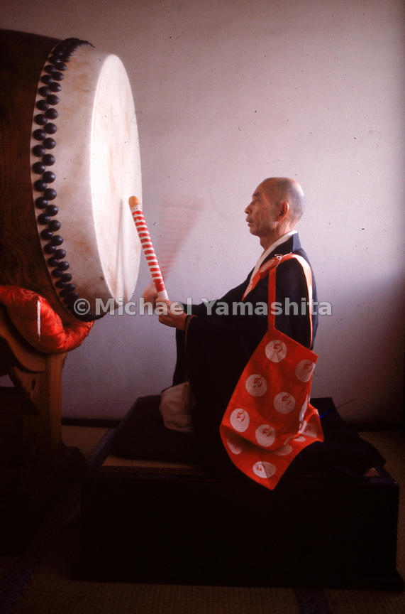 The vast majority of Japanese consider themselves adherents of both Buddhism and Shinto. Here a priest of the Nichiren sect beats a drum at Myorenji, a temple famed for its 17th-century raked rock garden located in the Nishijin textile artisan district of Kyoto.
