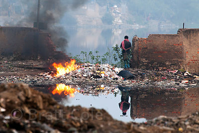 A fire burns at the Dhapa Dumping Ground, the main landfill for Kolkata, India.