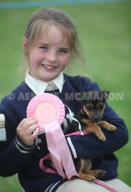 Scenes from the Headford Gymkhana and Dog show which took place last Sunday, June 12th. Pictured is Cadhla Cunningham from Cross with puppy 'Izzy'.   Photograph by Aengus McMahon NO REPRO FEE Photograph by Aengus McMahon NO REPRO FEE
