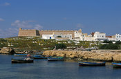 The Kabash (12th century) and cemetery next to a small fishing harbour, Hammamet, Tunisia