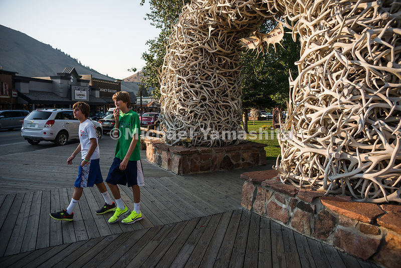 Elk Antler Arches at the entrance to Town Square. Jackson, Wyoming...Jagged peaks of the Teton Range, lush meadows, dense forests and deep lakes, define this Park, which also teems with wildlife. Highest peak is 13,770ft., park encompasses 485sq. miles.