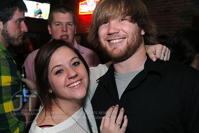 Bar patrons react to the camera at the Airliner Bar, 22 S Clinton Street in downtown Iowa City Saturday night. Copyright Justin Torner 2012 http://justintorner.photoshelter.com