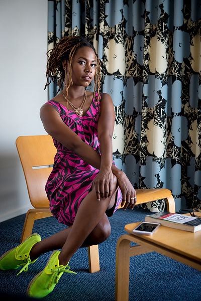 Valerie Idehen, a television development executive, relaxes in her hotel room in Los Angeles