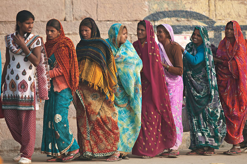 This photograph of a group of women chatting while waiting in the queue was shot during the Kumbh Mela.