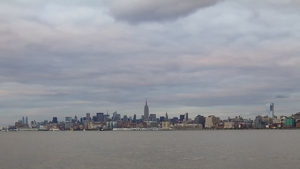 Medium Shot: Manhattan Skyline & Hudson River Blanketed With Low Cumulus (Day to Night)