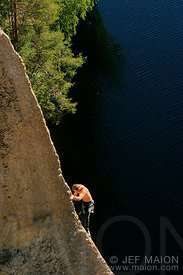 Climber above a lake