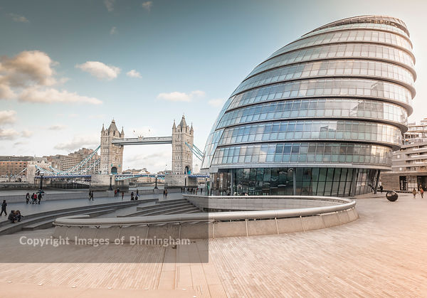 Tower Bridge, crossing the River Thames, and City Hall at the More London Development.