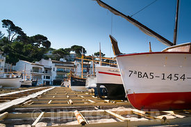 Moored boats and seaside residences at Begur, Spain