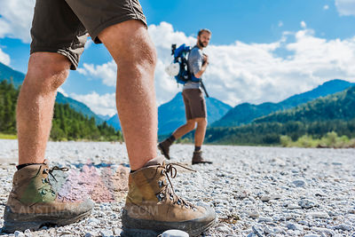 Germany, Bavaria, legs of hiker walking in dry creek bed