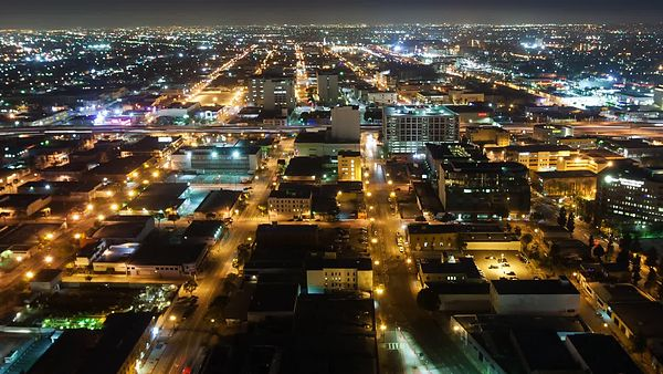 Bird's Eye: Pulsing Grid Of Parallel Streets Bathed In Night Light