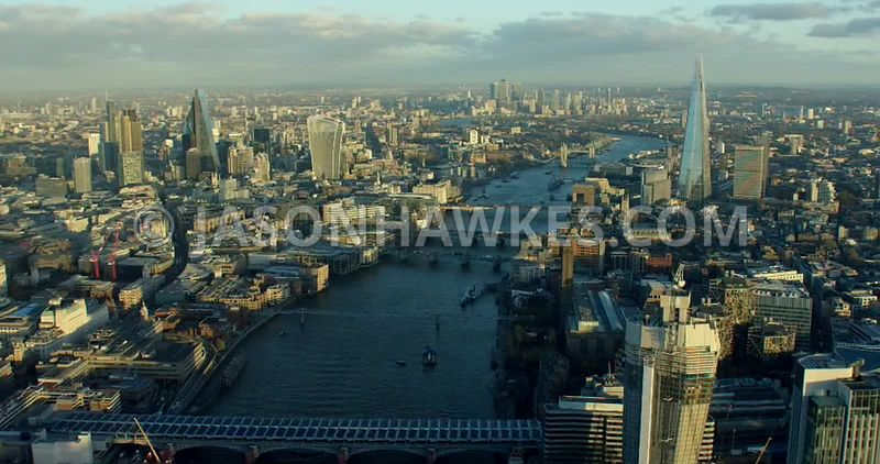 Aerial footage of River Thames as it flows between Southwark and the City of London