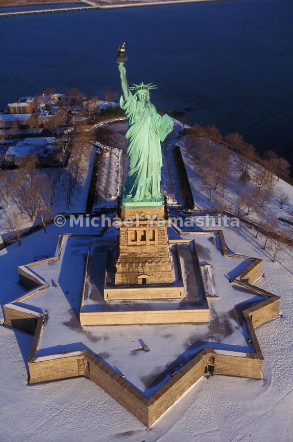 "In summer's heat and winter's snow, the Statue of Liberty's torch gleams gold, and as Edouard-Rene Laboulaye, the man who conceived of the idea of the statue once said, it is ""not an incendiary  torch, but one that lights the way."""