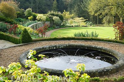 Circular pond on the terrace. Forest Lodge, Pen Selwood, Somerset, UK