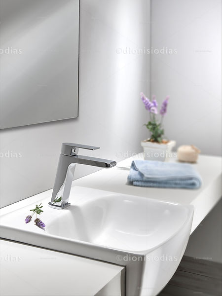 Diagonal view of bathroom sink counter decorated with lavender flower