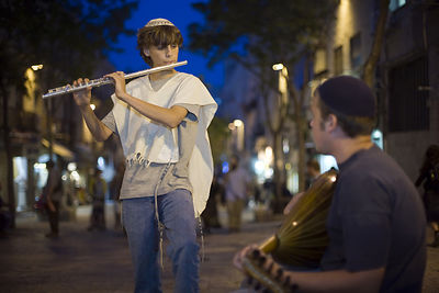 Israel - Jerusalem - Boys dressed in traditional Israeli and Jewish clothes play the flute and mandolin on Ben Yahuda Street