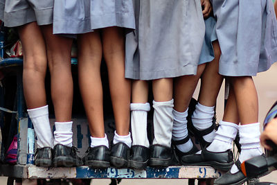 Girls in uniform on their way to school on a cycle rickshaw in Delhi, India
