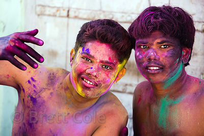 Boys covered in gulal powder during the Holi festival, Pushkar, Rajasthan, India