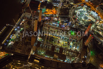 Night aerial view showing construction of Battersea Power Station development.