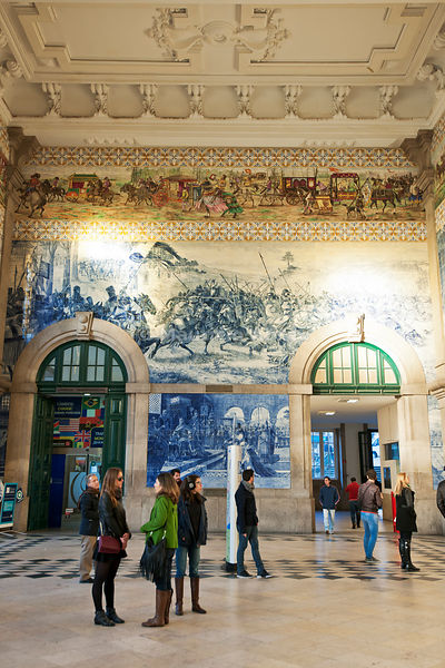 Decorative tiles inside São Bento railway station. Oporto, Portugal