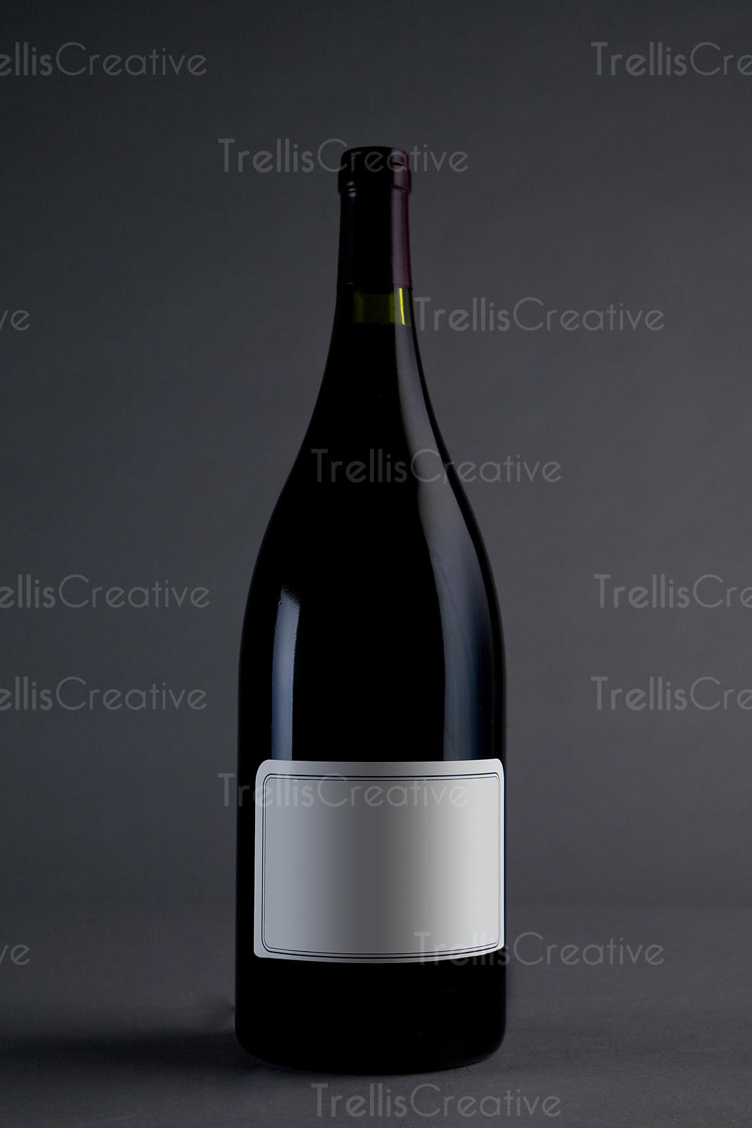Red rhone style wine magnum bottle with cream colored blank label