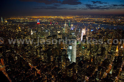 Night aerial view over midtown with the The Citigroup Centre and its 45° angled roof (formerly Citicorp Centre now 601 Lexington Avenue) on 53rd Street in the foreground and the Empire State Building in blue and red lighting in the background