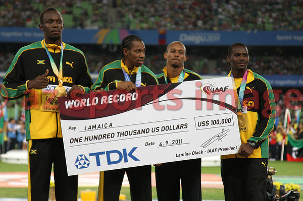 The Jamaican 4x100m team set a new world record of 37.04 at the IAAF World Championships. Team members Nesta Carter, Michael Frater, Yohan Blake and Usain Bolt celebrated their victory with gold medals and a check for $100,000.