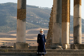 A tourist at the Roman Ruins Volobulus near Meknes in Morocco