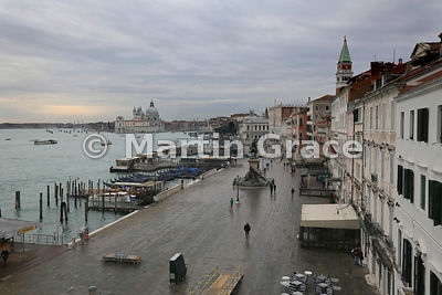 Early morning view of Santa Maria della Salute church and paved Riva Degli Schiavone from the roof terrace of Hotel Locanda Vivaldi, Venice, Italy
