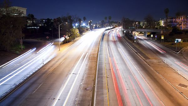 Medium Shot: Hanging Out Over The Light Trails Of A Busy Highway
