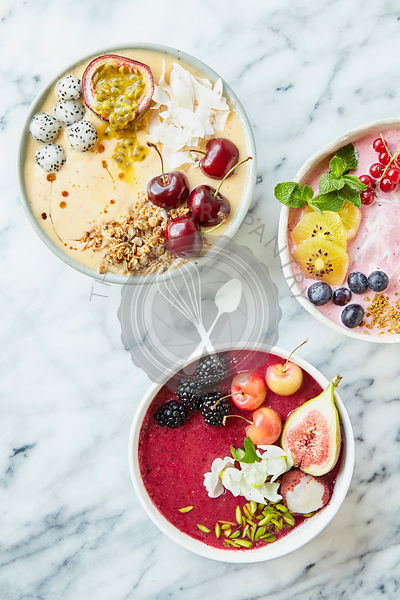 Decorated Smoothie Bowls on marble table