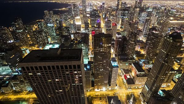 Bird's Eye: Medium Shot - High Above Lights, Streets, & the High-rises