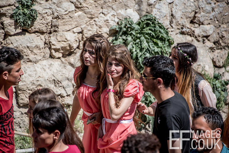 Yezidi Girls Walking In The Street At Red Wednesday, Or Yezidi New Year, Celebrations In Lalish, Iraq. 19th April 2017