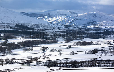Looking over Threlkeld towards the mountains in the Lake District in winter from Blencathra.