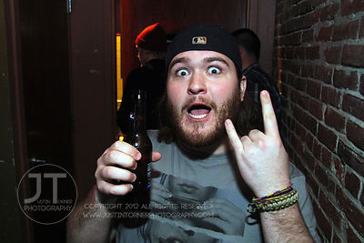 A bar patron reacts to the camera at the Airliner Bar, 22 S Clinton Street in downtown Iowa City Saturday night. Copyright Justin Torner 2012 http://justintorner.photoshelter.com