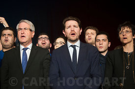 "Philippe Richert, chief région ""Grand Est"", Boris Ravignon, mayor of Charleville-Mézières; Bérangère Poletti, member of Parliament and menber of ""les Républicains"" singing the Marseillaise at the end of the Fillon meeting at Charleville-Mézières, France, on February 2, 2017."