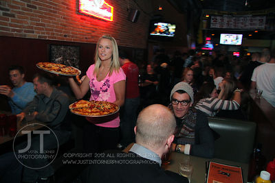 A server prepares to box up pizza for customers at the Airliner Bar, 22 S Clinton Street in downtown Iowa City Saturday night. Copyright Justin Torner 2012 http://justintorner.photoshelter.com