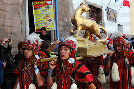 Bearers carry a golden puma during street processions for Inti Raymi festival, Cusco, Peru