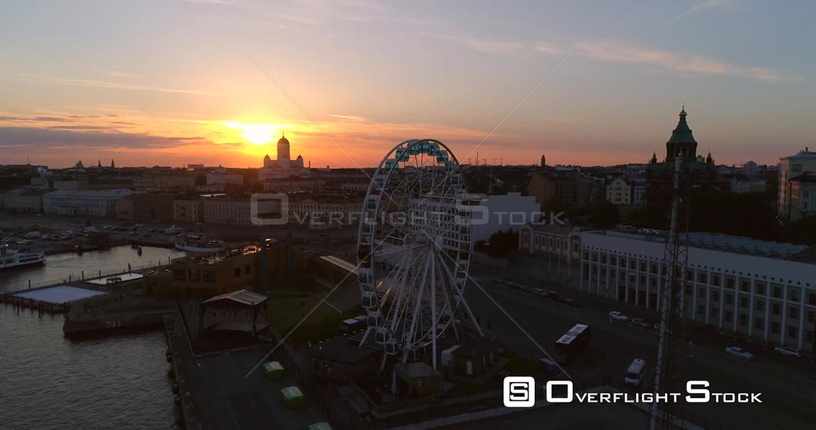 Sunset City, Aerial Tilt View of the Helsinki Skywheel Ferris Wheel and the Market Square and South Harbour, on a Sunny Summer Evening Dusk, in Helsinki, Uusimaa, Finland
