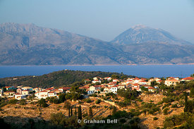 Evening view of the village of Katomeri with the mountains of mainland Greece in the disyance, Meganisi Island, Greece.