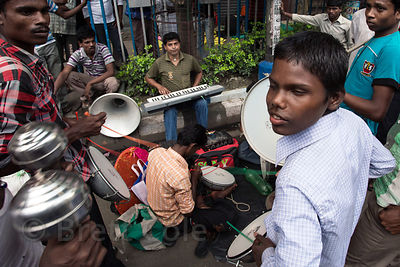 Musicians perform on a street in Bhawanipur, Kolkata, India