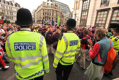 Two Police Officers in Large Crowd